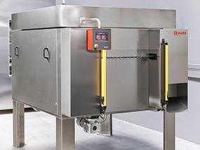 Wärmeschrank mit integriertem Transportsystem und Kühlzone für ein prozessicheres Wärmebehandeln von Bauteilen